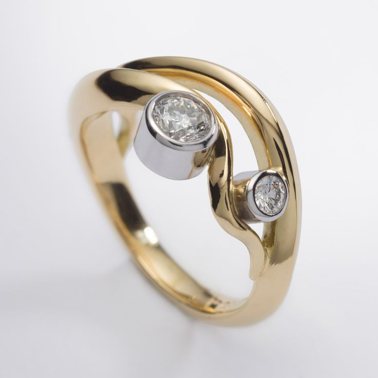 18ct yellow gold wave style engagement ring with 0.35ct diamonds in 18ct white gold settings. Engagement rings Cork city.