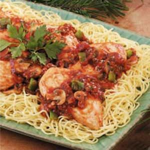 Zippy Chicken Cacciatore Recipe -For an entree with Italian flair, try these tender chicken breasts simmered in a nicely seasoned tomato sauce. The sauce has chunks of green pepper and mushrooms, and gets a little zip from balsamic vinegar and red pepper flakes. —Test Kitchen