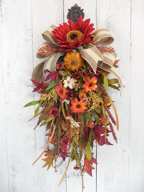 How to Use Flowers for a Beautiful Fall Door Swag. #wreath #swag #flowers