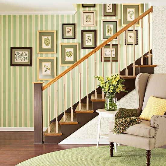 Whip a blank wall into shape with an artful arrangement of prints, paintings, plates, or photographs.