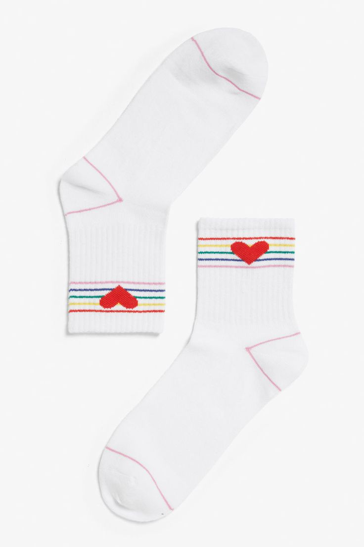 A pair of ribbed sport socks with multi-coloured stripes and hearts? Yes please!