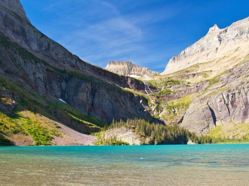Glacier National Park hikes are some of the most scenic in the world. Read about our first-hand experiences hiking in Glacier National Park.