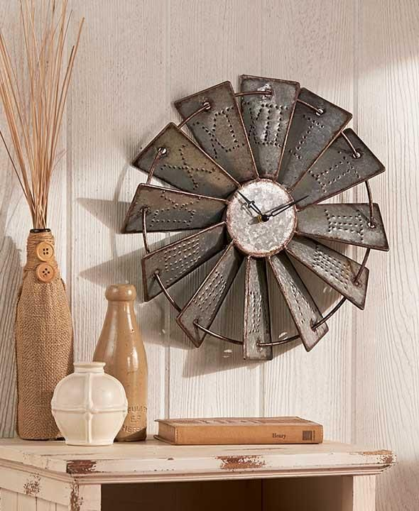 Inspired by a classic farm landmark, this Metal Windmill Wall Clock is the perfect coordinating piece for your country decor. Each blade has the hour embossed i