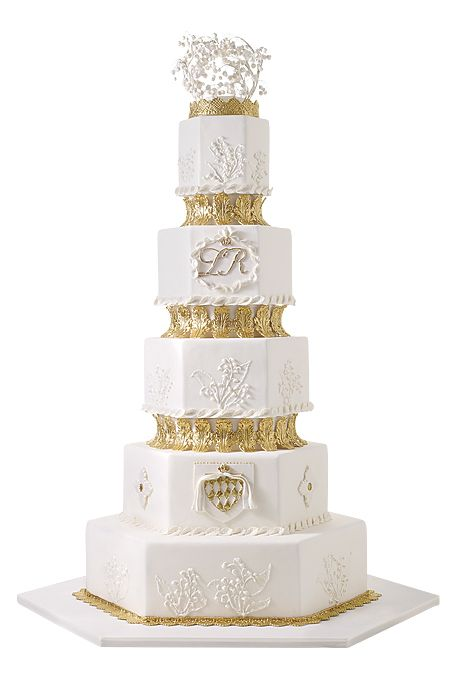 Brides.com: . Ana Parzych Custom Cakes, New York and Connecticut. Party like a British monarch at your wedding with a six-tier white and gold creation like this cake. If you're celebrating in the evening, nothing's more stately than the soft glow of silver candelabras and a really big cake. Princess Grace of Monaco's towering six tiers were modest compared with most monarchs'. (Kate had eight!)  Six-tier white and gold wedding cake, $23 per slice (serves 200), Ana Parzych Custom Cakes  See…