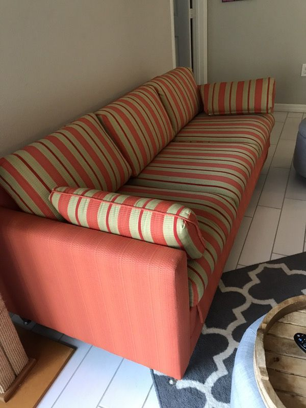 Two couches for sale. A Cindy Crawford love seat. And a orange sleeper sofa.