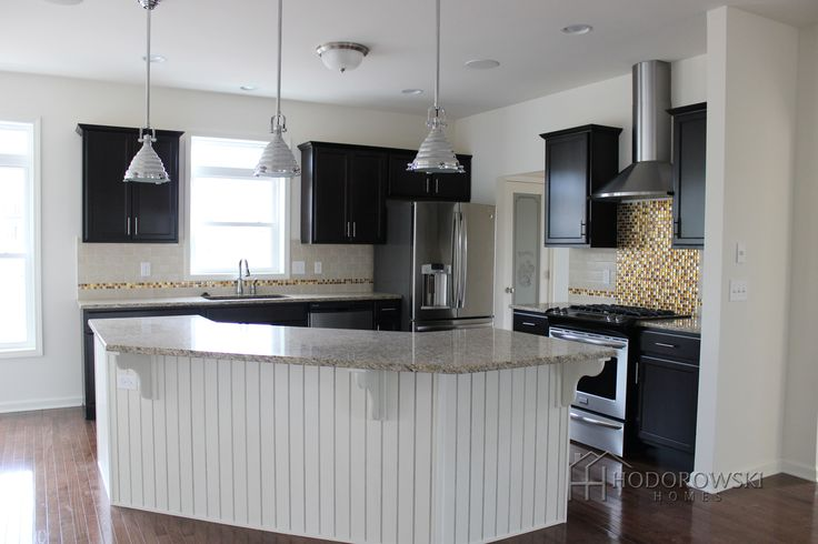 Picture perfect kitchen white wainscot island with java for The perfect kitchen island