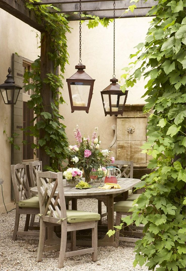 Lovely outdoor area with arbor and vine