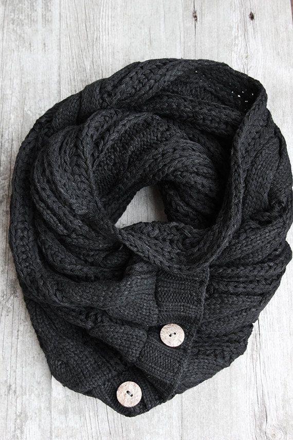 Black cable knit scarf with 3 wooden buttons. Keep your man warm this winter.        .DETAILS.  .sewn in our studio using cable knit fabric .64in L x