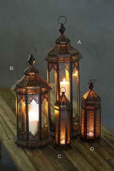 <p>Bring a warm amber glow to your porch or hearth with these gorgeous metal Moroccan lanterns, rich in detail with...