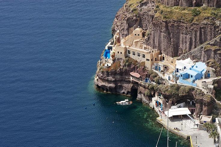 Fira, Santorini - built into the cliff    (via athenasuites.com)