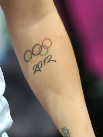 Detail photo of anOlympic tattoo on Kelsi Fairbrother of Great Britain - Women's Handball #Olympics