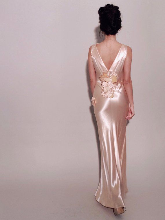 5ecfe74513a3de Jean Harlow, eat your heart out! The Old Hollywood glam of the '30s comes  to life in this liquid satin peach evening gown. Bias cut to delicately  drape your ...