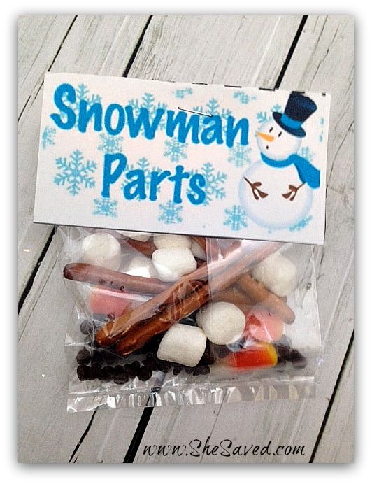 Snowman Parts!  Mini marshmallows, chocolate chips, pretzel sticks, candy corn.  Too cute!!!
