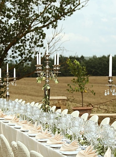 A wedding in Tuscany long white tables