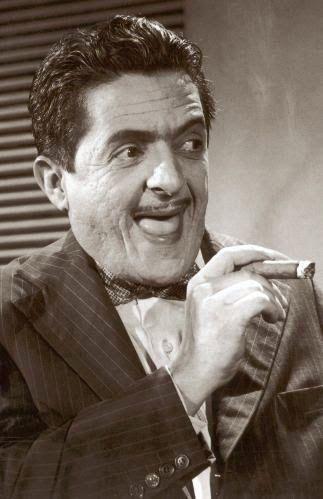 """Zé Trindade, pseudônimo de Milton da Silva Bittencourt foi um ator, músico e poeta brasileiro, grande comediante de rádio, teatro, cinema e TV, nascido em Salvador, no dia 18 de abril de 1915, e falecido no Rio de Janeiro no dia 2 de maio de 1990. Zé Trindade ficou famoso por jargões como """"Mulheres, Cheguei!"""" e """"Meu Negócio é Mulher""""."""