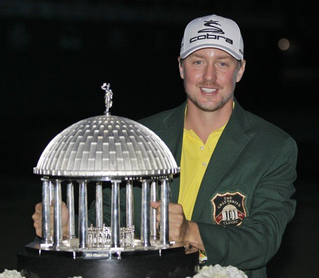 Jonas Blixt, of Sweden, holds the trophy after winning the Greenbrier Classic PGA golf tournament in White Sulphur Springs, W.Va., Sunday, July 7, 2013. Blixt overcame a four-shot deficit at the start of the final round and finished at 13 under. (AP Photo/Steve Helber)