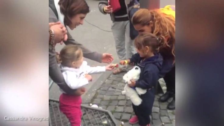Touching moment: German girl hands refugee child a sweet