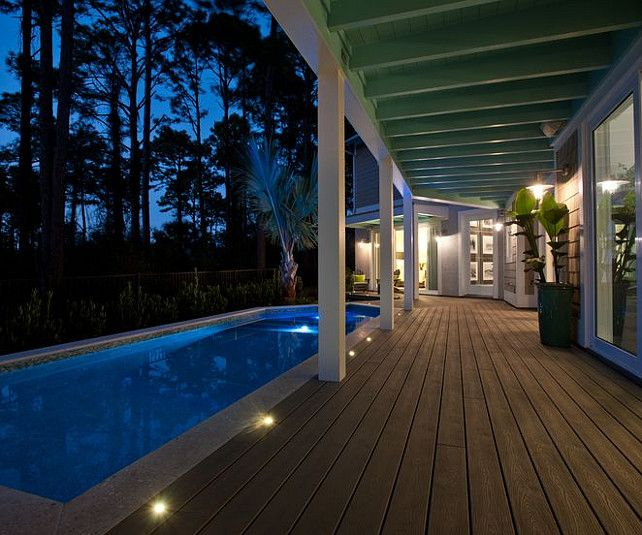 Love the pool placement with the covered porch adjacent. (notice the recessed lighting)  So practical. Transitional Beach House