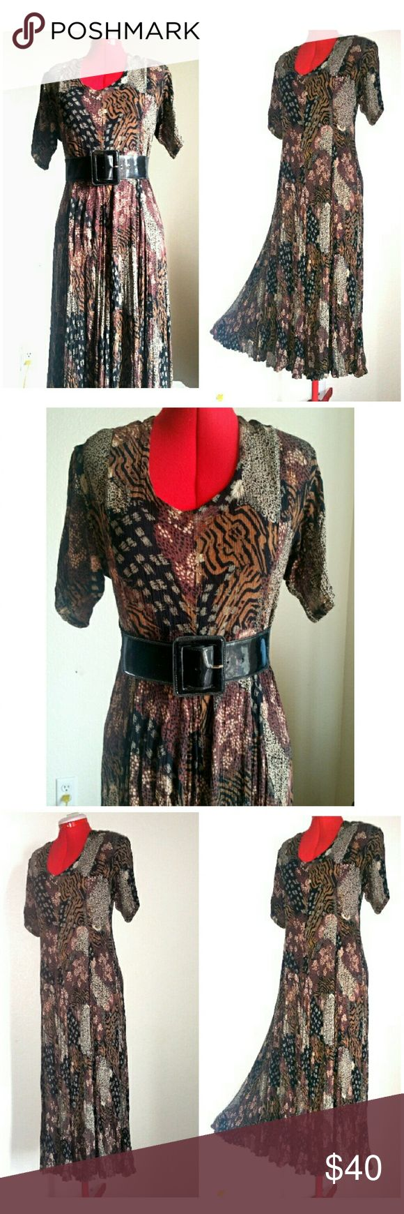 Vtg. Starina Animal Print Flowy Dress Festival This is a lovely crinkle gauze rayon dress from the 90s.  A dancing or festival must-have!  Midi/maxi length with short sleeves and is pull-over style.  Starina, size small.  Absolutely perfect, no issues and looks barely used. Vintage Dresses Midi