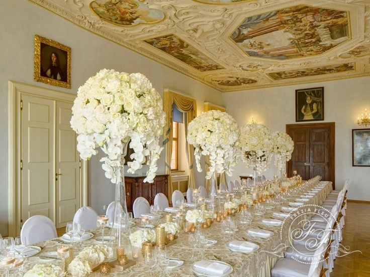 luxury centerpiece on long table small flower centerpieces tall rich flower arrangements on glass bell vases with decorated candle holders and mercury