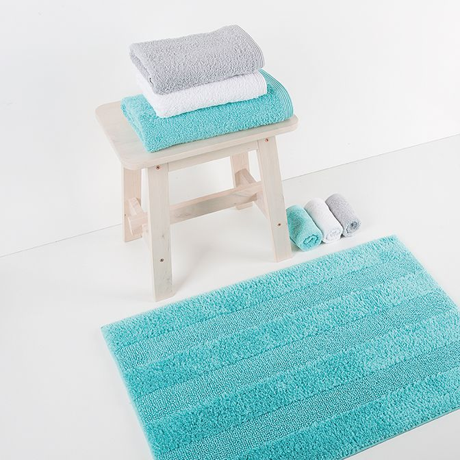 New Plus bath rug. Available in 24 colours. Reversible.