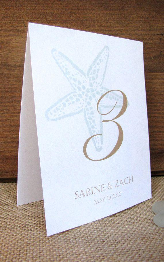 Número de mesa de boda de playa  estrellas de mar tabla