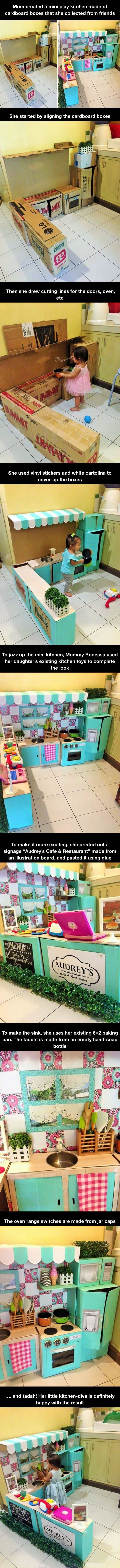 Mini play kitchen made of cardboard boxes