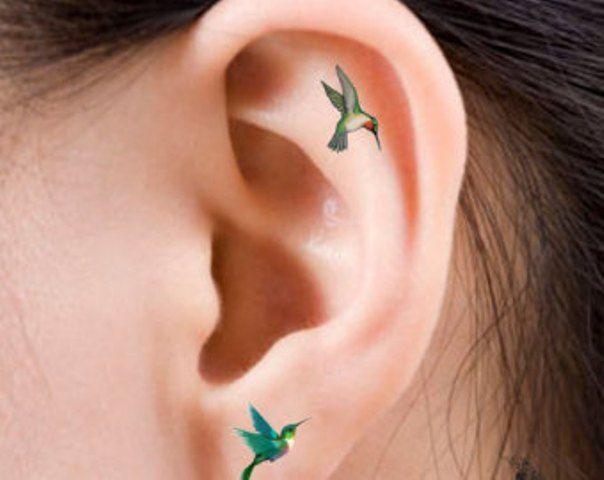 Feminine Hummingbird Tattoos on Ear                                                                                                                                                                                 More