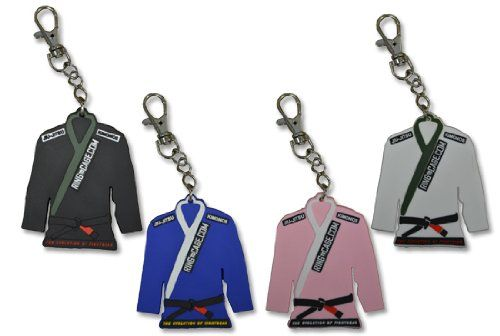 Ring to Cage Jiu Jitsu Gi/ Kimono Key Chain - Rubber 3.5 inches long. You will get 4 Gi Key chains of White Blue Black and Pink color...