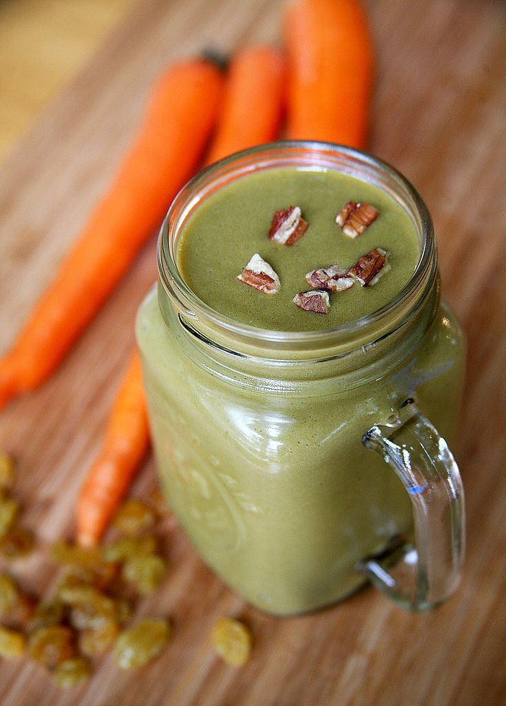 A 300-Calorie Carrot Cake Smoothie With Almost 20 Grams of Protein  2 medium carrots, peeled and chopped 1/2 frozen banana 2 cups spinach 1 cup unsweetened soy milk 1/2 scoop vanilla protein powder (I used Sunwarrior) 1/8 cup golden raisins 1/2 teaspoon cinnamon Dash of ground nutmeg Dash of ground cloves 3 ice cubes