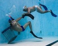Uncanny Sports: Underwater Rugby! Imagine a two rugby teams playing a match in a swimming pool and you have Underwater Rugby.  Each team uses full snorkeling equipment. They try to score goals at the bottom of the pool.