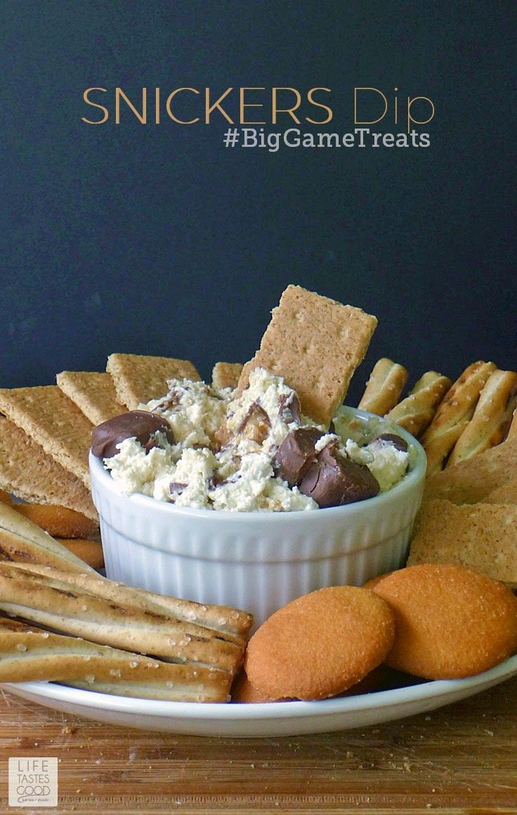 SNICKERS Dip | by Life Tastes Good is a sweet, creamy, dip perfect for the Big Game! This sweet cream cheese dip is loaded with SNICKERS Bites and a great dip for pretzels, apples, cookies, and graham crackers too!