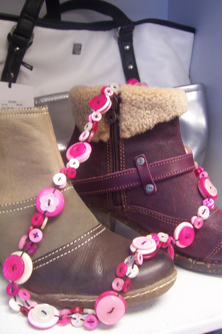 Pink button necklace displayed at 2-Shoes #button #necklace