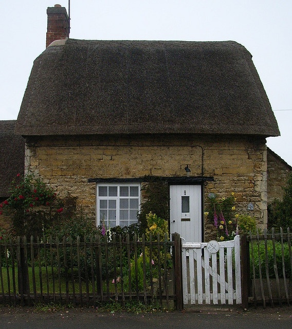 Thatched roof cottage.