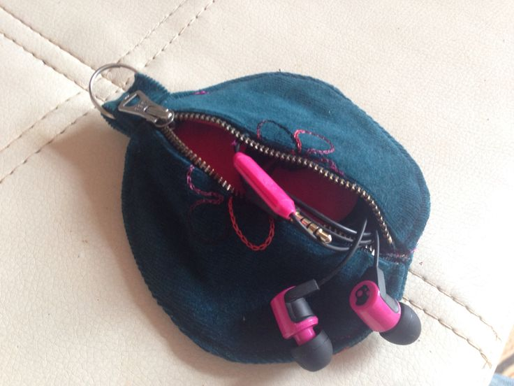 I tired of my headphones always getting tangled and damaged in my bag. Upcycled fabric scraps and a zipper from a pair of pants.
