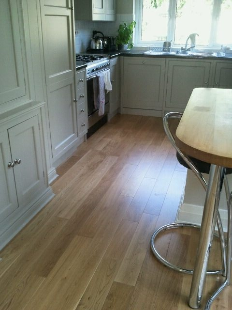 Solid easy-fit real wood in kitchen fitted by Fitmywoodfloor.