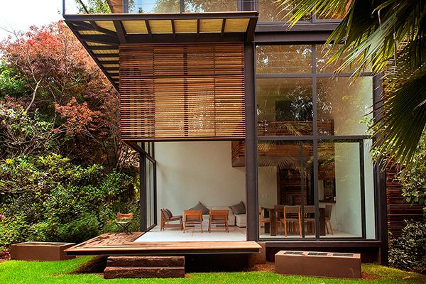 Private Garden in México Accommodating Four Wooden Houses