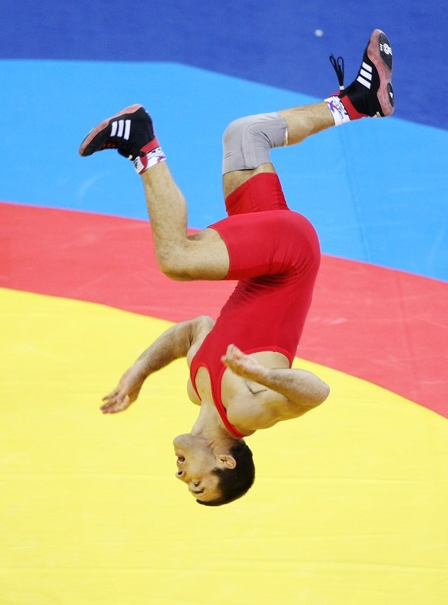 Inspirational Moments: Olympic celebrations - BEIJING - AUGUST 19: Radoslav Velikov of Bulgaria celebrates by doing a flip after defeating Namig Sevdimov of Azerbaijan in the bronze medal bout during the men's 55kg freestyle wrestling event at the China Agriculture University Gymnasium on Day 11 of the Beijing 2008 Olympic Games on August 19, 2008 in Beijing, China. (Photo by Jed Jacobsohn/Getty Images)