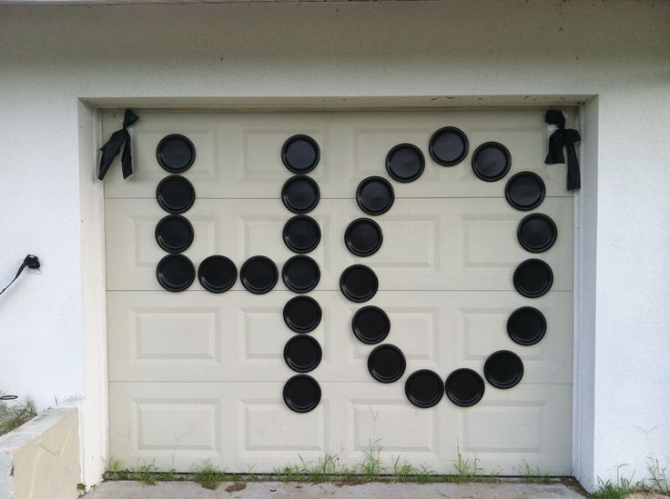 "Quick, easy and inexpensive way to display a large message! Use paper plates (dollar store) and tape. Perfect for ""punking"" someone on their birthday! I punked my neighbor on his 40th birthday....$2.00 worth of black paper plates from the dollar store and about a $1 worth of packing tape to adhere the plates to his garage door."