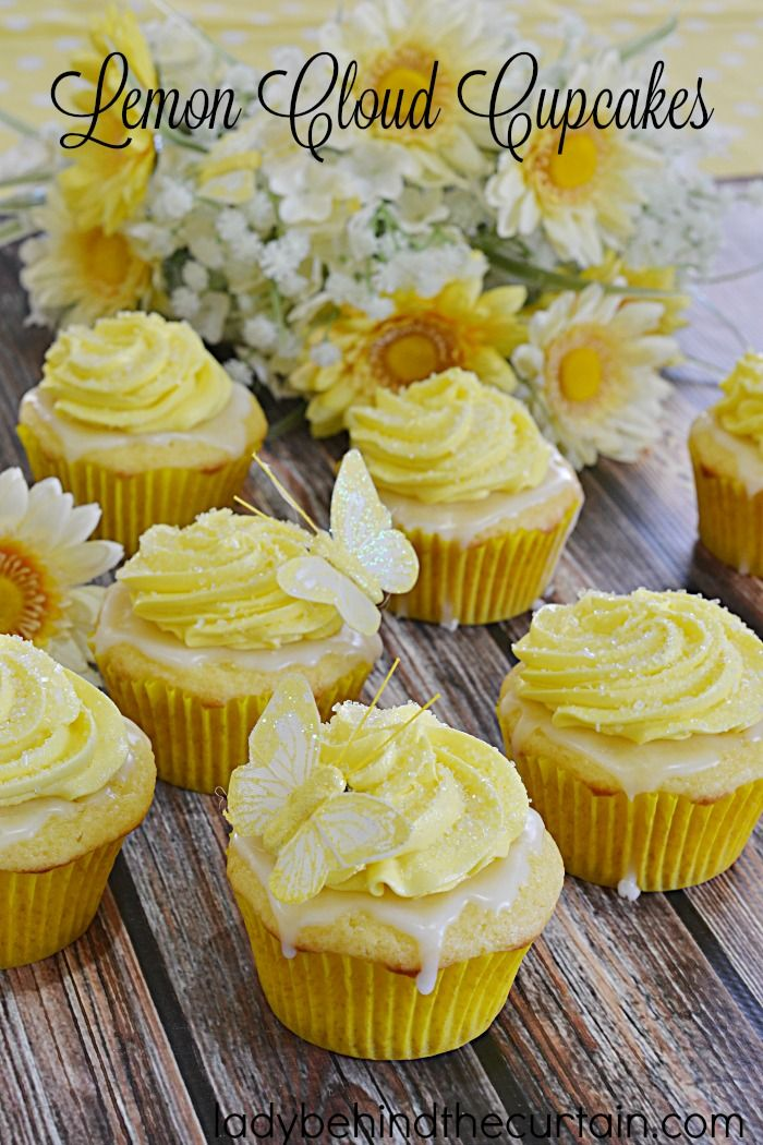 Lemon Cloud Cupcakes | Layers…..it's all about layers with this cupcake.  Starting with a light and fluffy cupcake then a glaze full of lemon tartness all topped with the most delicious lemon butter frosting!
