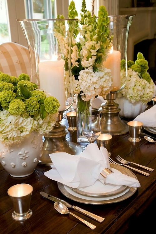 Lovely, White dishes with gold trim. Napkins on top, Centerpiece are big and fluffy hydrangeas.