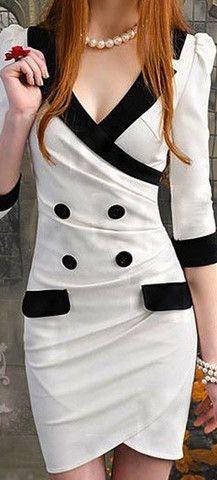 Me encanta este vestido con vivos negros sobre el blanco