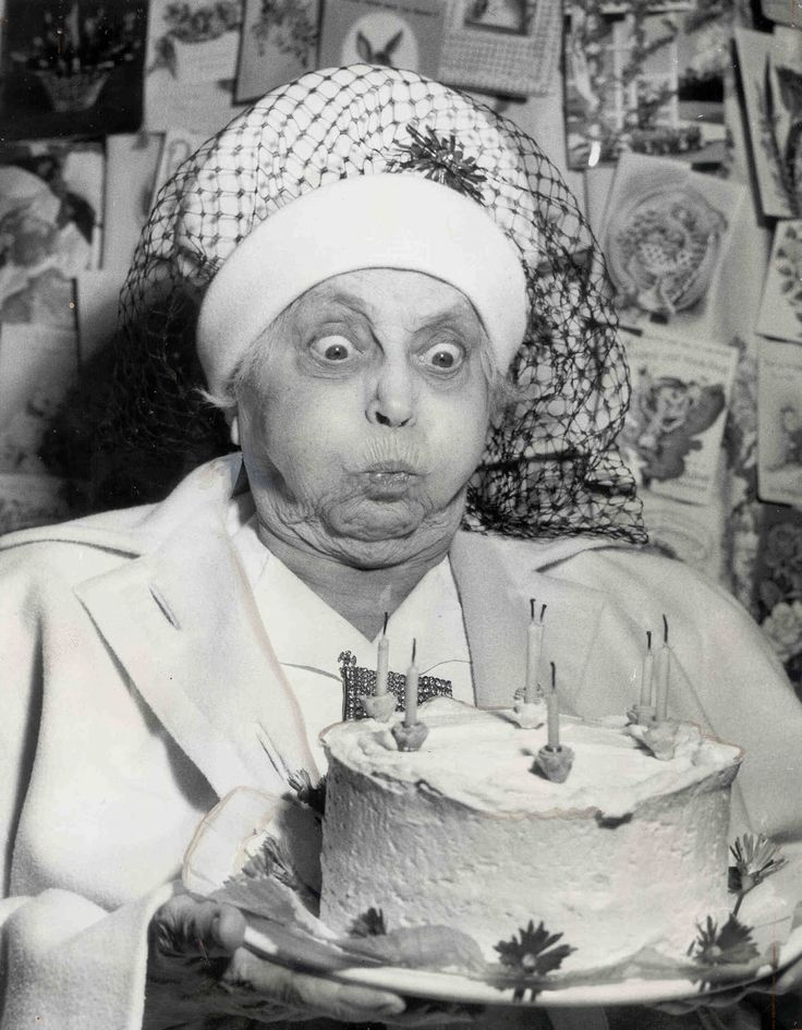 Blowing out the candles.. this is one great photograph. she really wants them out and i adore her hat