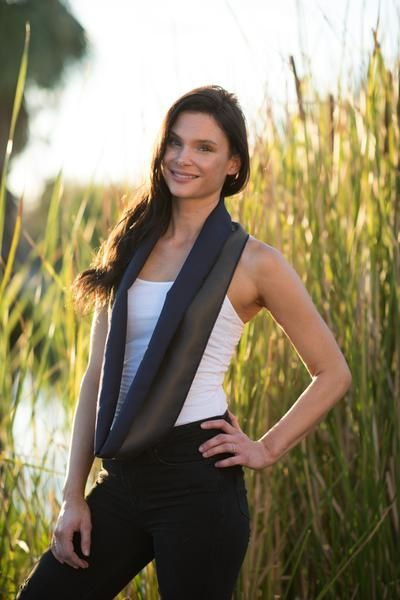 $34.00 100% of the profit from your purchase is used to help women in Afghanistan fight for equality and keep their children in school  Our Tuxedo Scarf is reversible and moldable, making it perfect for dressing up an outfit or adding it as a layer to business casual. One side is dark silver gray, the other navy with nude and mango stripes. This piece is a showstopper and can be worn infinity style or open.