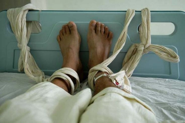 A file photo of a patient at a psychiatric hospital in Fuzhou receiving a blood transfusion with bound feet.