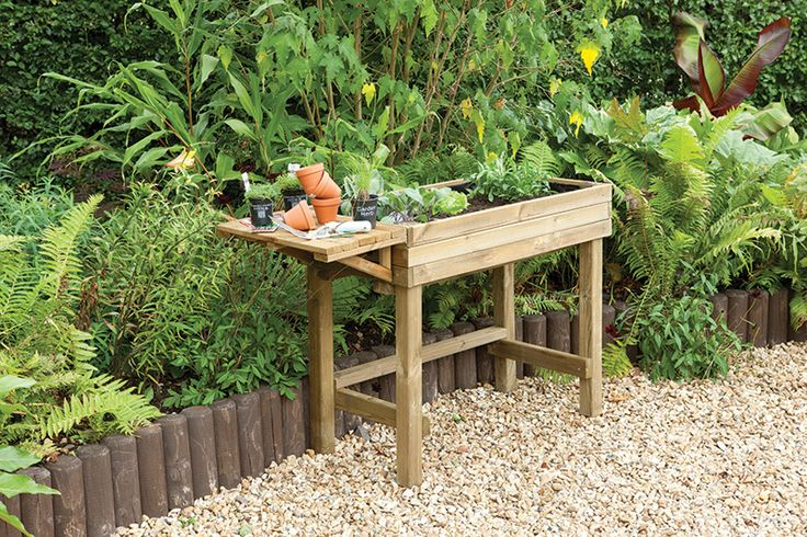 Trough Table Planter | This high level trough makes gardening accessible to everyone, including the less-abled gardener, those with limited garden space and has also been designed with wheelchairs in mind. Designed with a handy fold down potting bench at the side. #woodenplanters