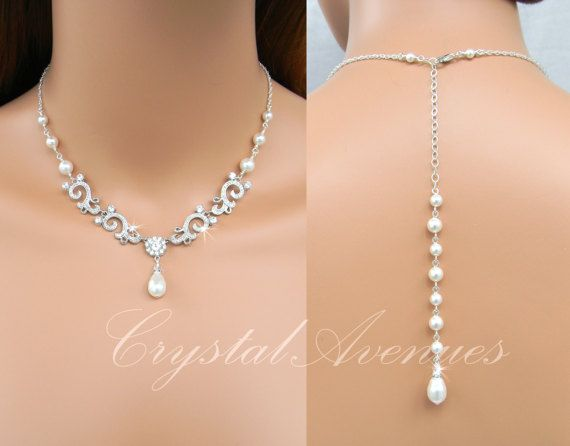 This listing is for the Taylor necklace with or without the backdrop. This necklace has been designed and made by CrystalAvenues. This is an original design of CrystalAvenues.  Ive created this dainty bridal necklace with Swarovski crystals and Swarovski pearls. The filigree crystal encrusted components create a delicate and romantic look and the necklace is finished off with either a high quality sterling silver chain OR rose gold-filled chain. I do not use plated chains.  Total length of…