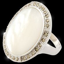 Va Va Voom!     This gorgeous stainless steel ring finished in rich rhodium dazzles with the beauty of natural mother of pearl surrounded with dozens of marcasite crystals.    Sizes 5 to 10  Nickel and lead free.