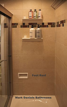 this is interesting open shower shelves and a foot rest