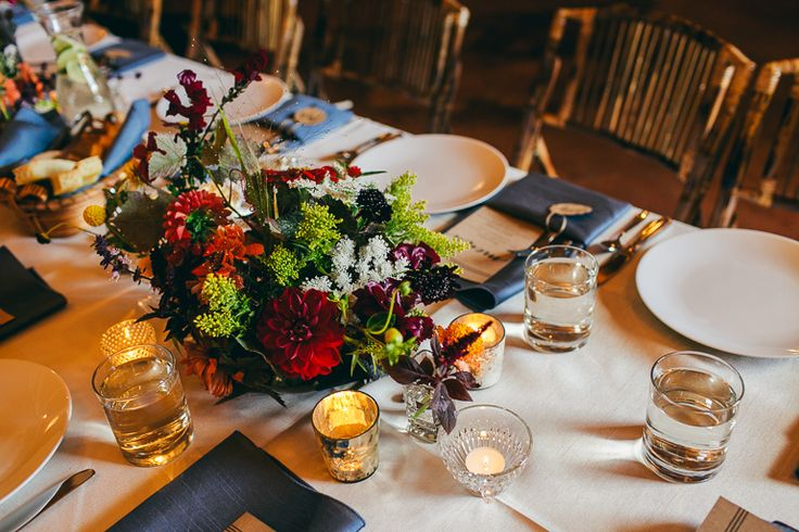 Seasonal (late August in the PNW), bohemian and slightly vintage wedding reception centerpieces with mixed votives and bud vases at Fireseed Catering by Flying Bear Farm + Design www.flyingbearfar... - Photography by Love Song Photo www.lovesongphoto...